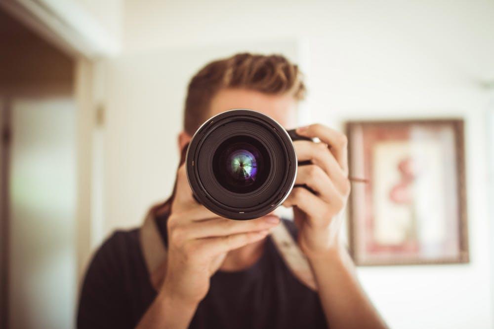 wedding photographer holding a camera