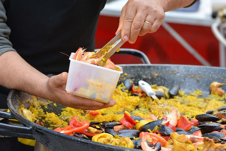 Man while servicing Paella catering in Sydney