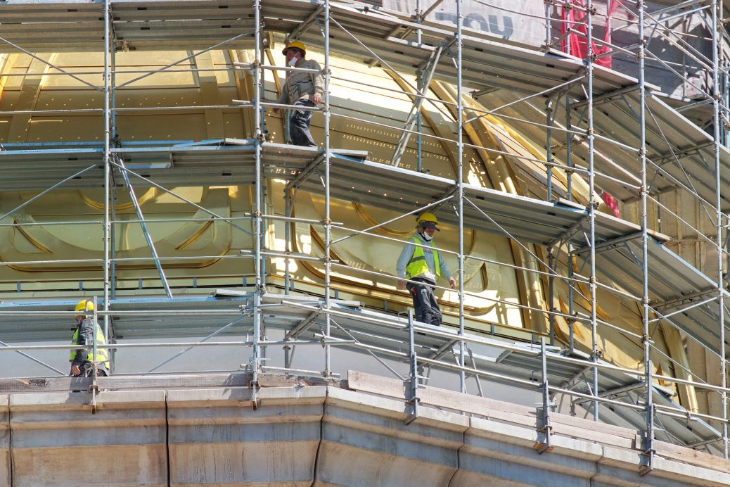 Workers of a construction site while in a kwikstage scaffolding