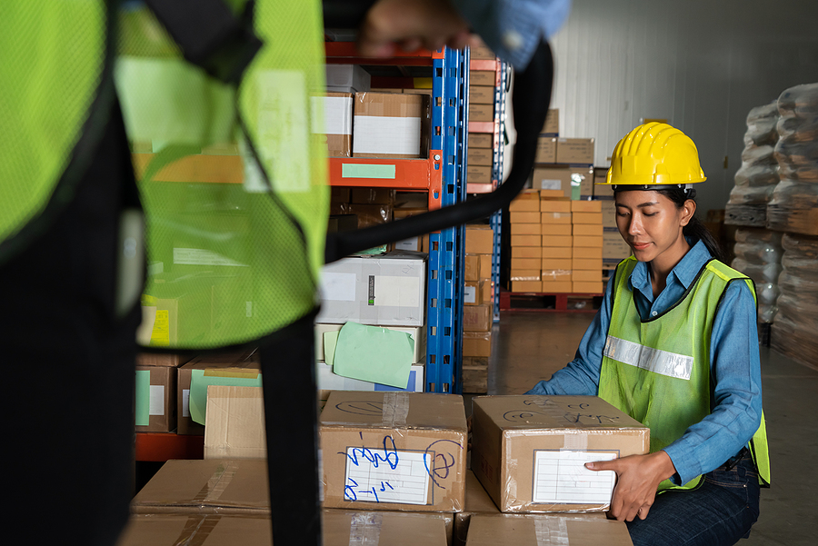 Female warehouse worker working at the storehouse